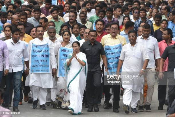 Trinamool Congress Supremo and Chief Minister of West Bengal Mamata Banerjee during a padayatra against the exclusion of 19 lakh people from National...