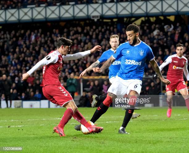 Trincao Francisco of Braga and Connor Goldson of Rangers during the UEFA Europa League round of 32 first leg match between Rangers FC and Sporting...