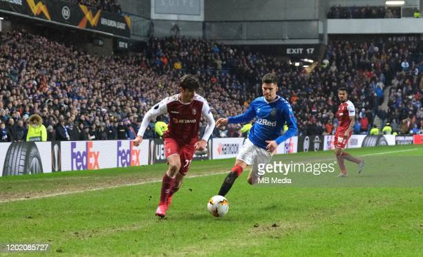 Trincao Francisco of Braga and Ianis Hagi of Rangers during the UEFA Europa League round of 32 first leg match between Rangers FC and Sporting Braga...