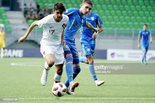 Trincao Francisco of Portugal and Kyrylo Dryshliuk of Ukraine vie for the ball during the football 2018 UEFA European Under19 Championship semifinal...