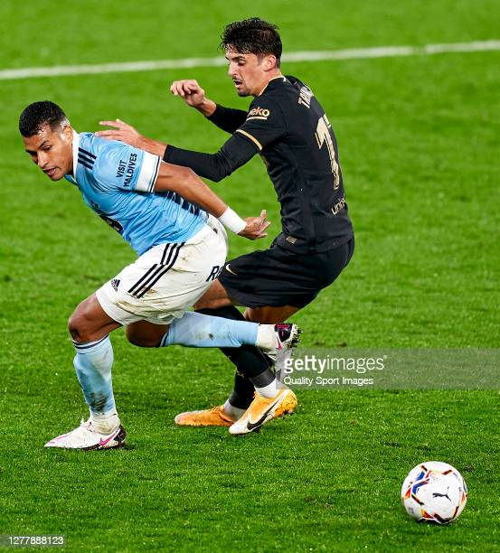 Trincao of FC Barcelona competes for the ball with Jeison Murillo of Celta de Vigo during the La Liga Santander match between RC Celta and FC...