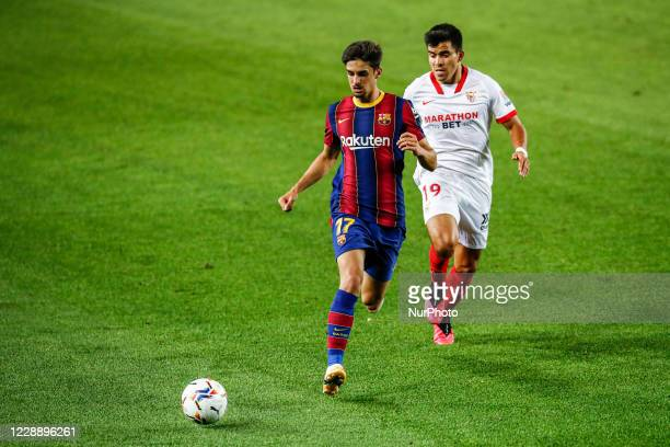 17 Trincao of FC Barcelona defended by 19 Acuna of Sevilla FC during La Liga match between FC Barcelona and Sevilla FC behind closed doors due to...