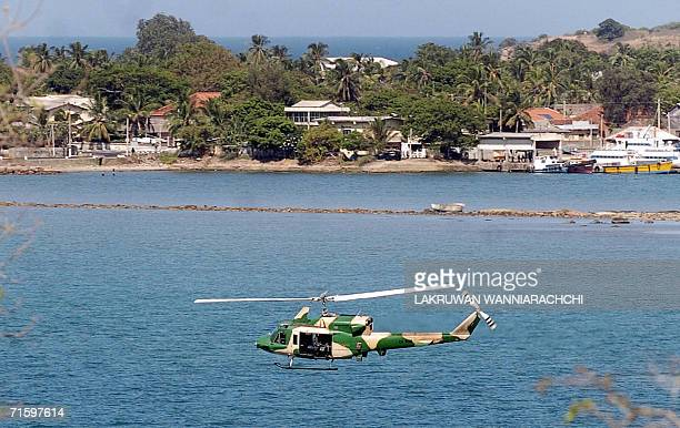 Sri Lankan military helicopter flies over the naval base in Trincomalee 07 August 2006 Sri Lankan troops launched fresh artillery attacks against...