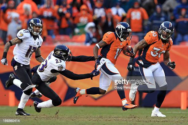 Trindon Holliday of the Denver Broncos returns a kickoff 104 yards for a touchdown in the third quarter against Chykie Brown of the Baltimore Ravens...