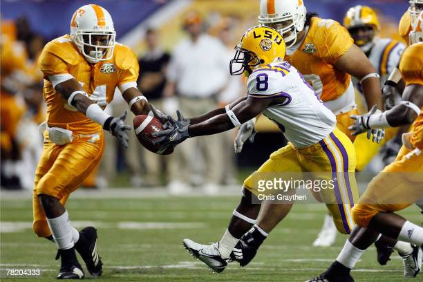 Trindon Holliday of the Louisiana State University Tigers fights for a fumble with Eric Berry of the University of Tennessee Volunteers in the SEC...
