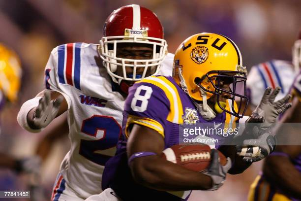 Trindon Holliday of the Louisiana State University Tigers runs past Dominique Faust of the Louisiana Tech Bulldogs on November 10 2007 at Tiger...