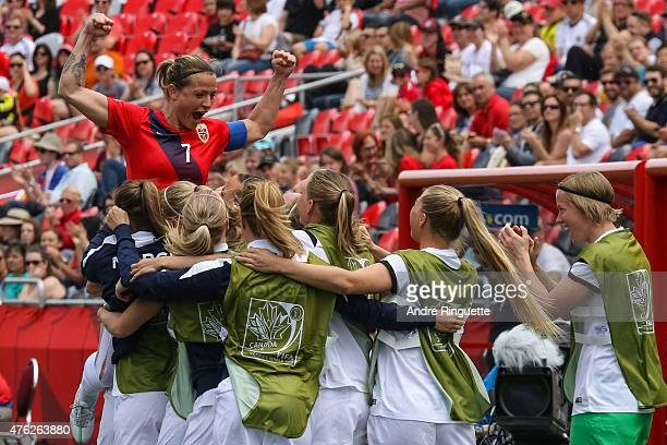 Trine Bjerke Ronning of Norway celebrates her goal against Thailand with teammates during the FIFA Women's World Cup Canada 2015 Group B match...
