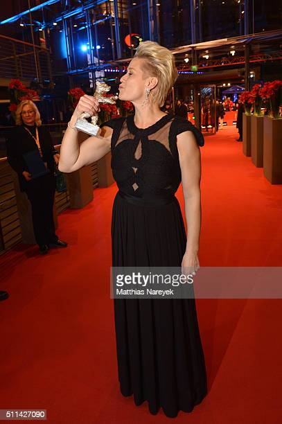 Trine Dyrholm, winner of the Silver Bear for Best Actress, poses with her award after the closing ceremony of the 66th Berlinale International Film...