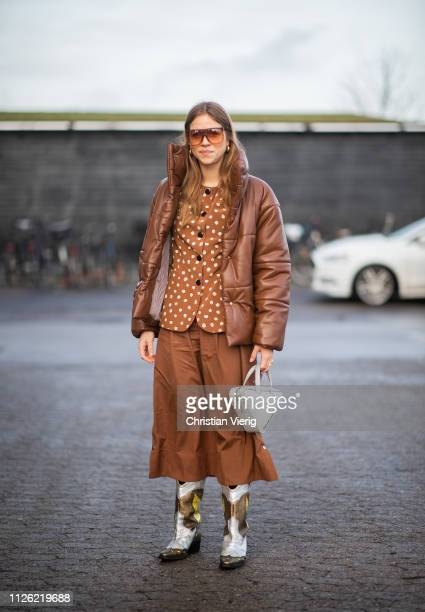 Trine Kjaer is seen weairng brown puffer jacket button shirt with dots print cropped pants Balenciaga bag cowboy boots outside Nanushka lunch during...