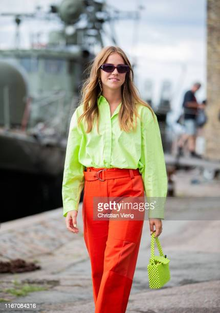 Trine Kjaer seen wearing neon green button shirt red pants outside Stine Goya during Copenhagen Fashion Week Spring/Summer 2020 on August 08 2019 in...