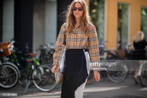 Trine Kjaer wearing asymmetrical skirt Burberry button shirt see through bag seen outside Blanche during the Copenhagen Fashion Week Spring/Summer...