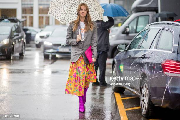 Trine Kjaer wearing pink sock boots clutch grey blazer floral print skirt outside J Lindeberg during the Copenhagen Fashion Week Autumn/Winter 18 on...
