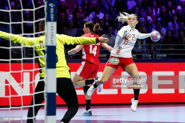 Trine Ostergaard Jensen of Denmark is shooting the ball against Adrianna Placzek of Poland during the EHF Women's Euro match between Poland and...