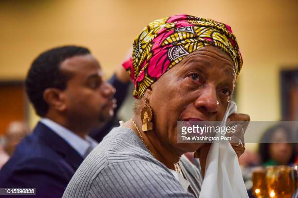 Trinette Chase sheds tears while listening to an uplifting song being sung by the Eastern Senior High School choir as senior citizens displaced by...