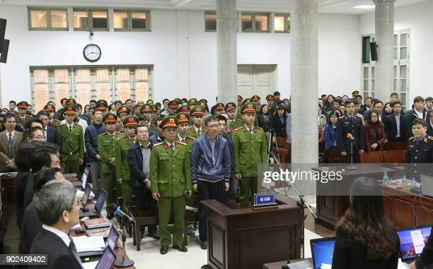 Trinh Xuan Thanh a former oil executive and others defendants stand trial at the courtroom of Hanoi People's Court on January 8 2018 The corruption...