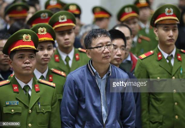 Trinh Xuan Thanh a former oil executive stands trial at the courtroom of Hanoi People's Court on January 8 2018 The corruption trial of a Vietnamese...