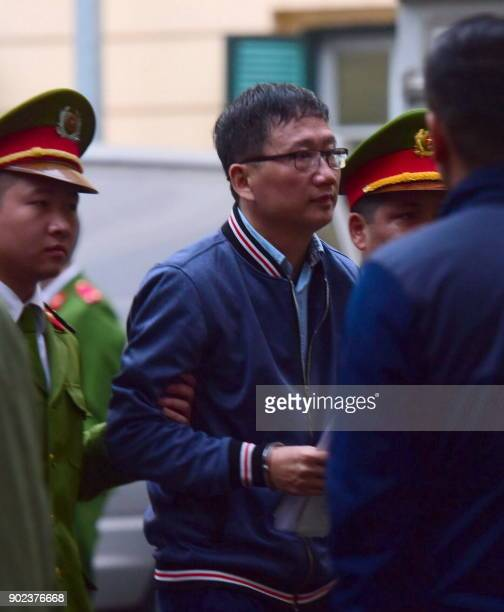 Trinh Xuan Thanh former oil tycoon who was reportedly kidnapped from Berlin by Vietnamese Security is lead by policemen to the courtroom at Hanoi...