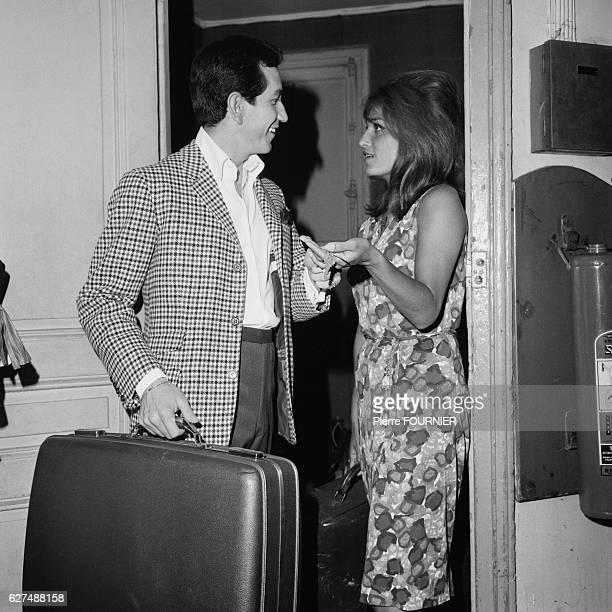 Trini Lopez and singer Dalida swap dressing room keys