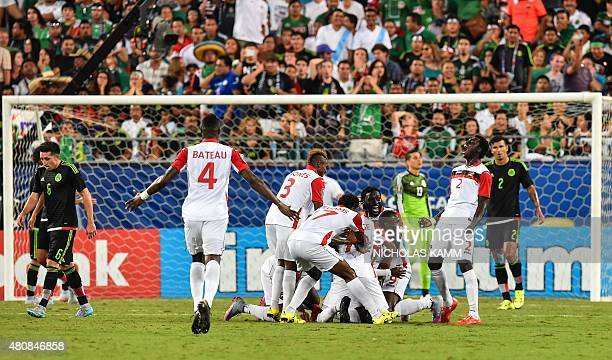 Trinidad and celebrates scoring against Mexico during a CONCACAF Gold Cup Group C match in Charlotte North Carolina on July 15 2015 AFP...