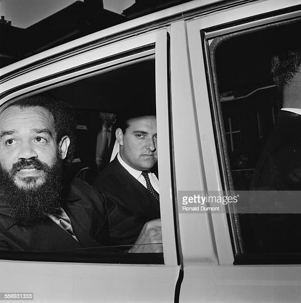 Trinidad and Tobago born civil rights activist Michael X leaving his Finchley home with detectives after his arrest under the Race Relactions Act...