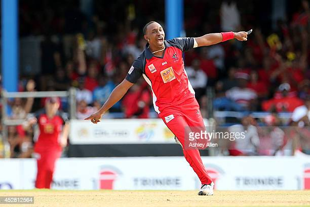 Trinidad and Tobago captain Dwayne Bravo celebrates getting a wicket during a match between The Trinidad and Tobago Red Steel and St Lucia Zouks as...