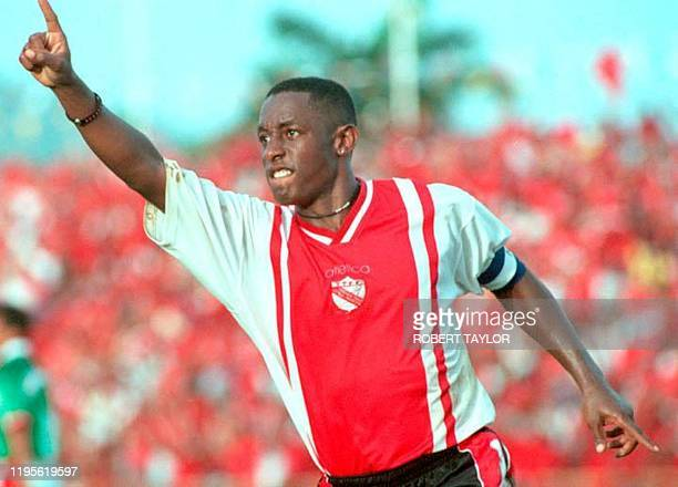 Trinidad and Tobago captain Russell Latapy celebrates after scoring the winning goal against Mexico during their Japan-Korea 2002 World Cup qualifier...