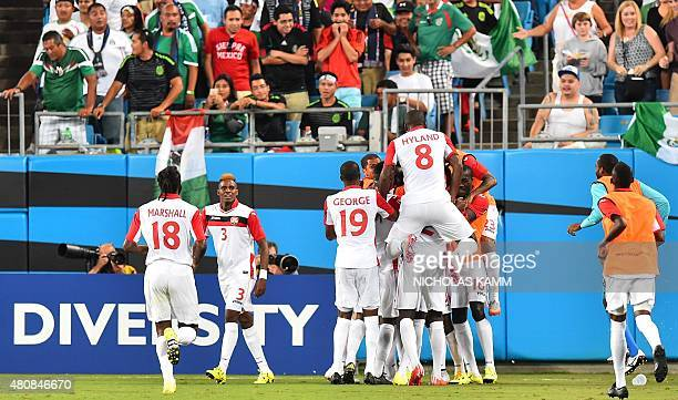 Trinidad and Tobago celebrates scoring against Mexico during a CONCACAF Gold Cup Group C match in Charlotte North Carolina on July 15 2015 AFP...