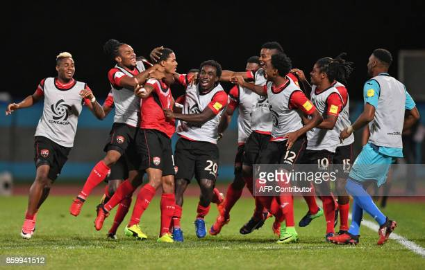 Trinidad and Tobago's Alvin Jones celebrates with teammates after scoring against United States during their 2018 World Cup qualifier football match...