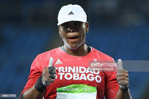 Trinidad and Tobago's Cleopatra Borel gestures in the Women's Shot Put Final during the athletics event at the Rio 2016 Olympic Games at the Olympic...