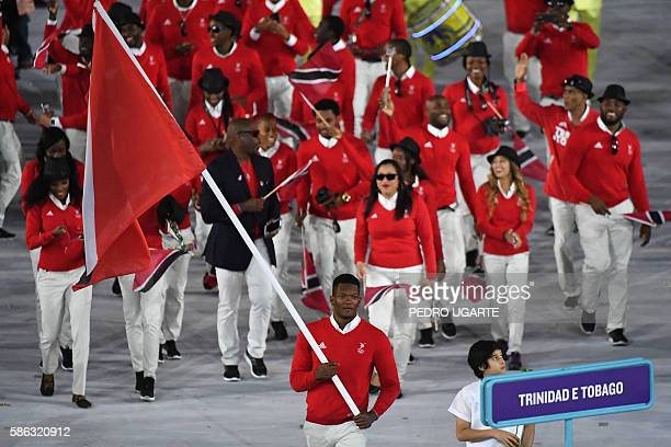 Trinidad and Tobago's flagbearer Keshorn Walcott leads his delegation during the opening ceremony of the Rio 2016 Olympic Games at the Maracana...