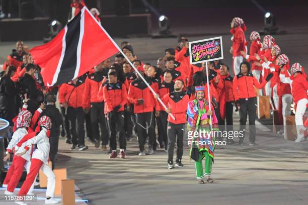 Trinidad and Tobago's flagbearer sailor Andrew Lewis leads his delegation during the Parade of Nations of the opening ceremony of the Lima 2019...