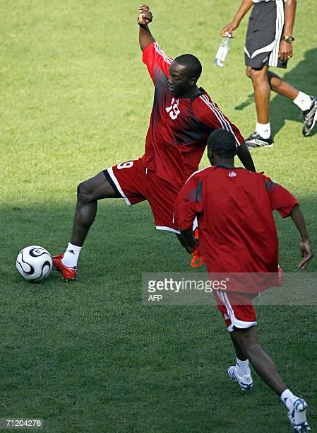 Trinidad and Tobago's forward Dwight Yorke controls the ball during a training session at Frankenstadion in Nuremberg 14 June 2006 Trinidad Tobago...
