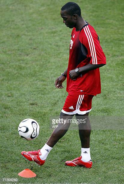 Trinidad and Tobago's forward Dwight Yorke plays with the ball during a training session at the Frankenstadion in Nuremberg 14 June 2006 Trinidad...