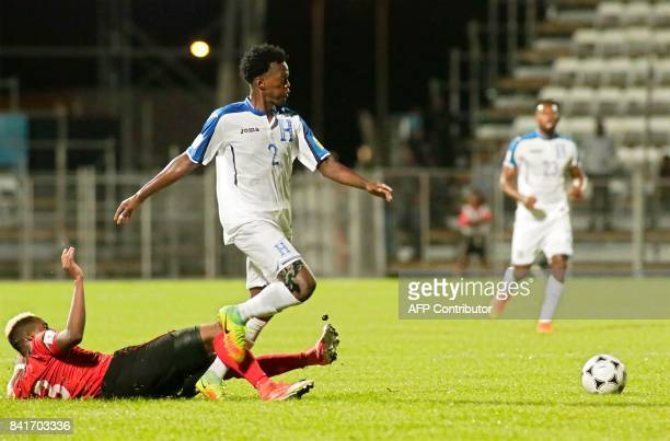 Trinidad and Tobago's Joevin Jones and Honduras' defender Felix Crisanto vie for the ball during their FIFA World Cup 2018 CONCACAF qualifiers...