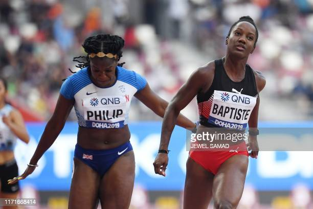 Trinidad and Tobago's KellyAnn Baptiste and Britain's Asha Philip compete in the Women's 100m heats at the 2019 IAAF World Athletics Championships at...