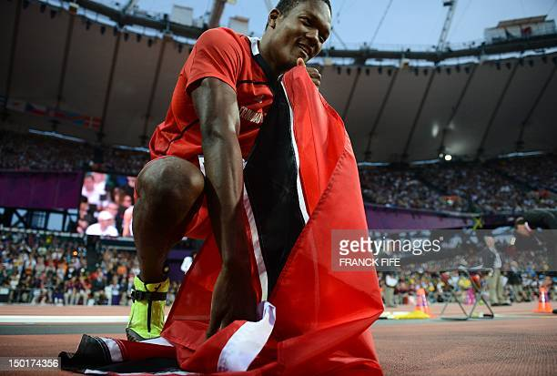 Trinidad and Tobago's Keshorn Walcott celebrates after winning the gold medal in the men's javelin throw final at the athletics event of the London...