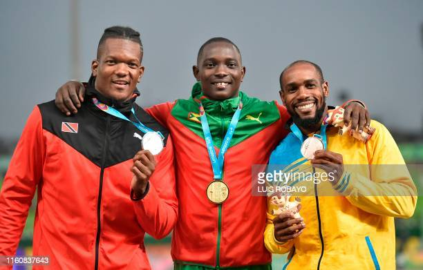 Trinidad and Tobago's Keshorn Walcott, Grenada's Anderson Peters and Saint Lucia's Albert Reynolds pose with their silver, gold and bronze medals...