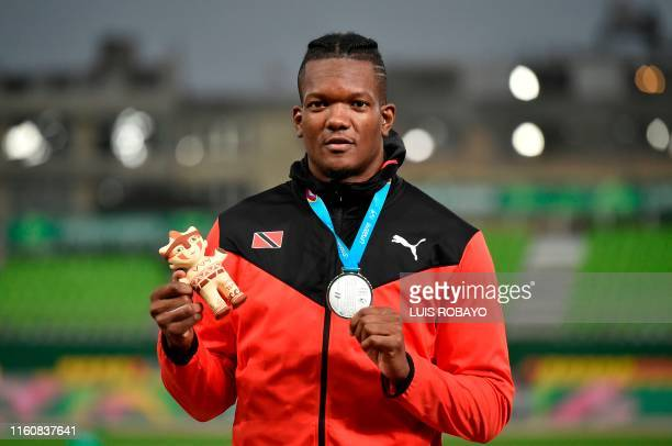 Trinidad and Tobago's Keshorn Walcott poses with his silver medal on the podium of the Athletics Men's Javelin Throw Final during the Lima 2019...