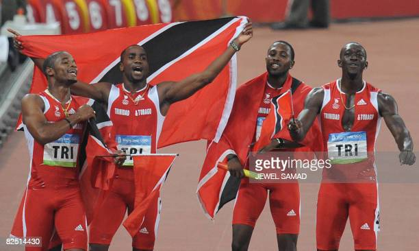 Trinidad and Tobago's Keston Bledman Emmanuel Callender Richard Thompson and Marc Burns celebrate after winning silver in the men's 4100m Relay final...