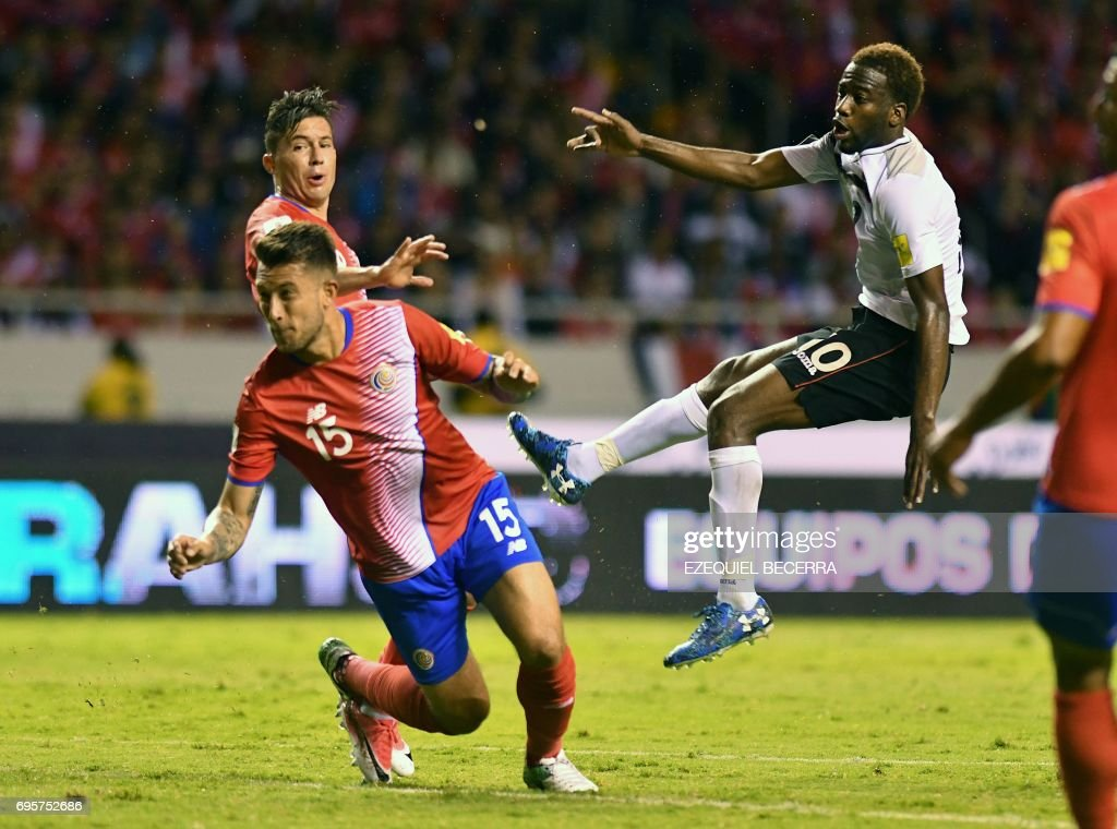 Trinidad and Tobago's Kevin Molino (R) celebrates after scoring against Costa Rica during a FIFA World Cup Russia 2018 Concacaf qualifier match in San Jose on June 13, 2017. / AFP PHOTO / Ezequiel BECERRA