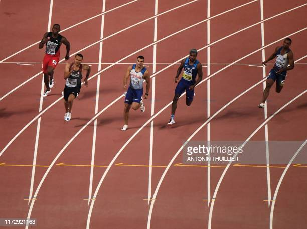 Trinidad and Tobago's Kyle Greaux Canada's Andre De Grasse Britain's Adam Gemili USA's Noah Lyles and Ecuador's Alex Quinonez compete in the Men's...