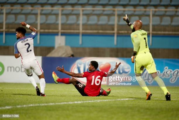 Trinidad and Tobago's Levi Garcia USA's DeAndre Yedlin and USA's goalkeeper Tim Howard complain during their 2018 World Cup football qualifier match...