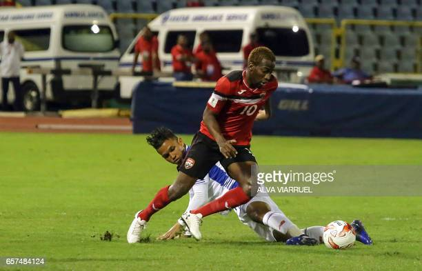 Trinidad and Tobago's midfielder Kevin Molino tries to control the ball past Panama's midfielder Amilcar Henriquez during their 2018 FIFA World Cup...