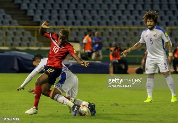 Trinidad and Tobago's midfielder Kevin Molino vies for the ball with Panama's midfielder Amilcar Henriquez during their 2018 FIFA World Cup qualifier...