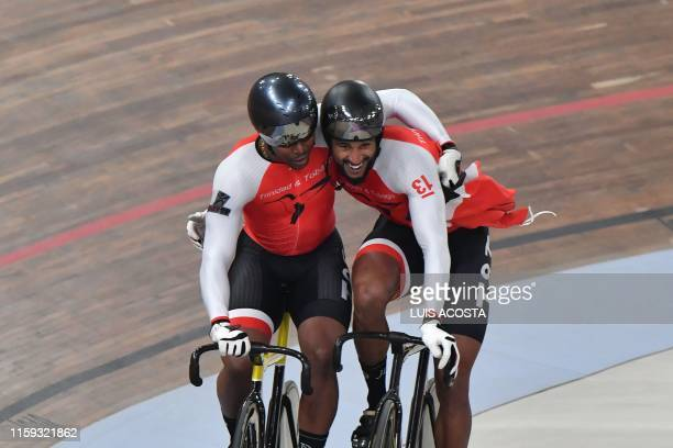 Trinidad and Tobago's Nicholas Paul and Njisane Phillip celebrate their gold and silver medals in the Men's Sprint Gold Final of the Track Cycling...