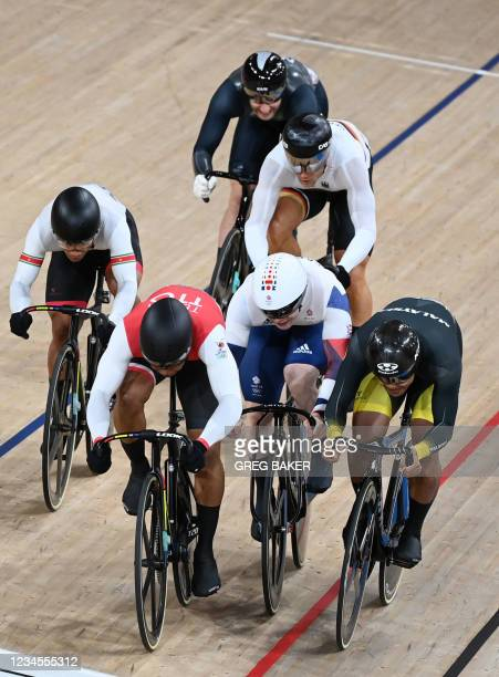 Trinidad and Tobago's Nicholas Paul, Britain's Jack Carlin and Malaysia's Muhammad Shah Firdaus Sahrom compete in a heat of the men's track cycling...