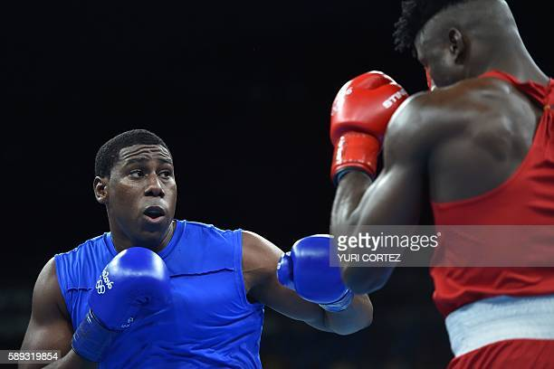 Trinidad and Tobago's Nigel Paul fights Nigeria's Efe Ajagba during the Men's Super Heavy at the Rio 2016 Olympic Games at the Riocentro Pavilion 6...