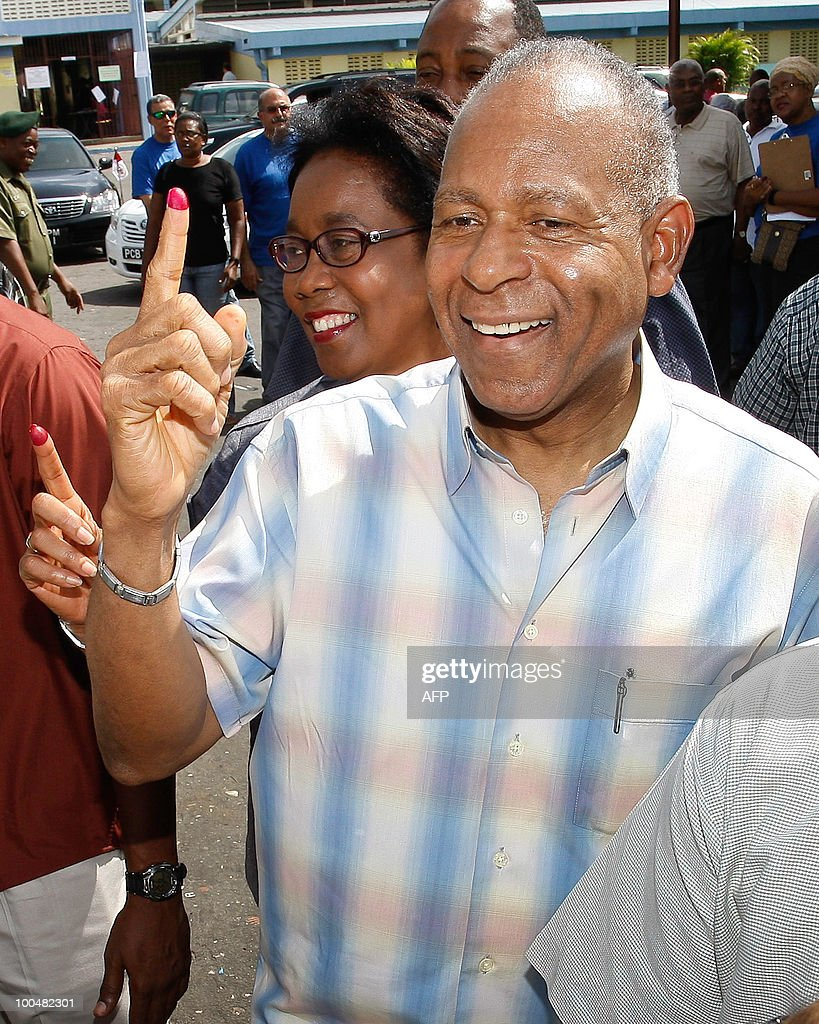 Trinidad and Tobago's PM Patrick Manning shows his dyed right index finger after casting his vote with his wife Hesell during the general elections May 24, 2010 in Port of Spain.