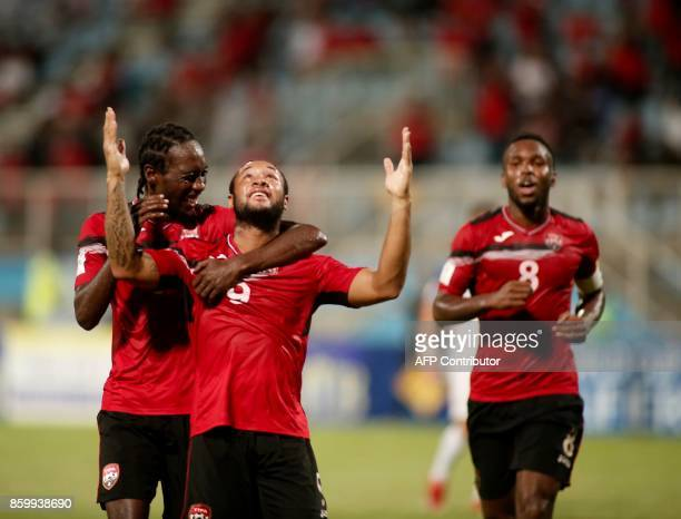 Trinidad and Tobago's Shahdon Winchester celebrates with teammates after scoring against the United States during their 2018 World Cup qualifier...