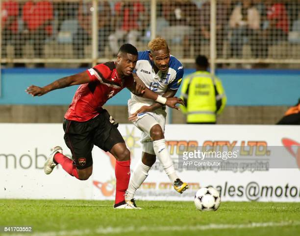 Trinidad and Tobago's Sheldon Bateau AND Honduras'midfielder Romell Quioto vie for the ball during their FIFA World Cup 2018 CONCACAF qualifiers...